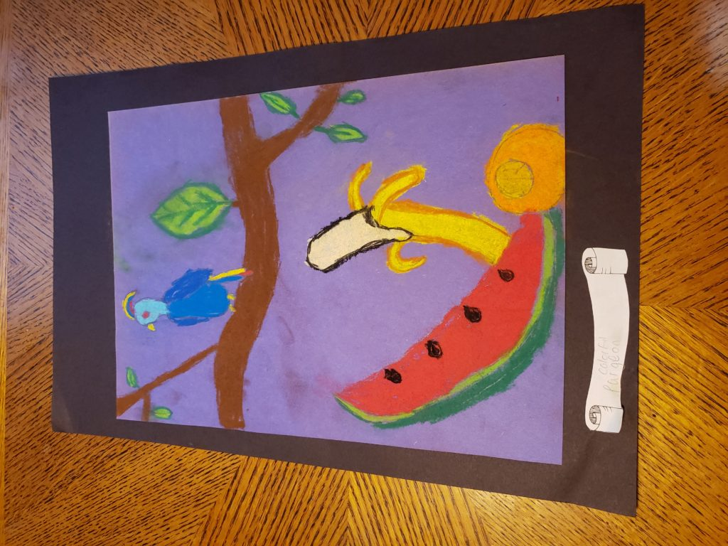 "A pastel drawing of fruit and a bird. A slice of watermelon sits next to an orange; a partially peeled banana stands behind both. Above the fruit is a branch with a few leaves and a blue bird with yellow crest and tail. A curling scroll below the drawing reads ""colorful pargeon"""