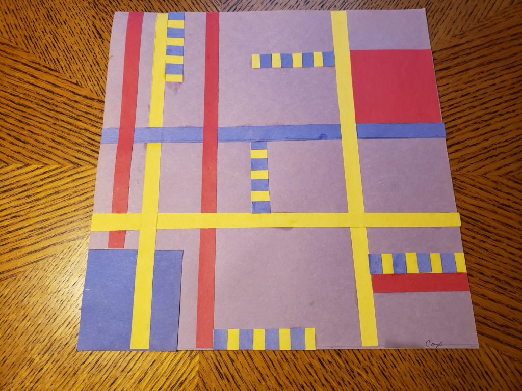 An abstract pattern collage using red, yellow, and blue paper on a pale purple background. Yellow, blue, and red strips divide the art into 9 sections, The leftmost 3 sections have two strips running vertically inside of them. There are several blue and yellow striped rectangles amongst the sections, a blue square in the lower left corner, and a red square in the upper right section.