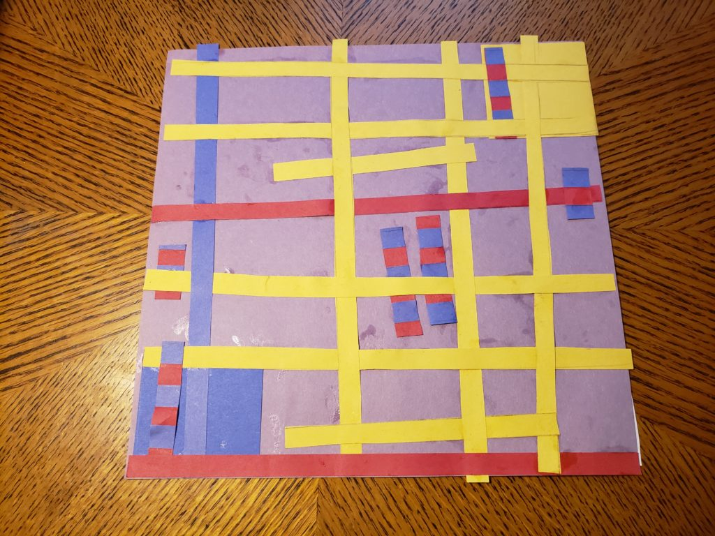 An abstract pattern collage using red, yellow, and blue paper on a pale purple background. Many yellow strips, two red strips, and one blue strip make up a grid. Several red and blue striped rectangles are woven into the grid. A blue square is in the lower left corner, while a yellow square is in the upper right corner; both are underneath the grid.