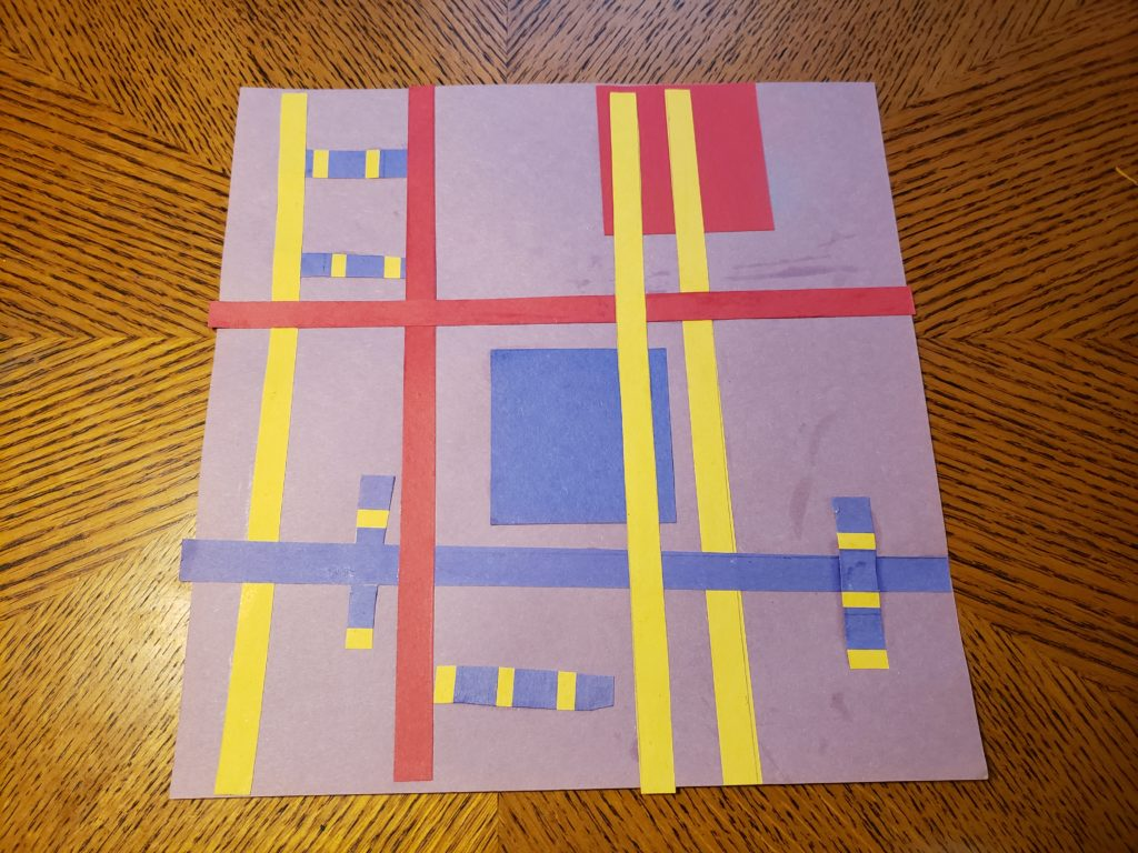 An abstract pattern collage using red, yellow, and blue paper on a pale purple background. The background is roughly divided into 9 square sections with strips of yellow, red, and blue. Several short rectangles with blue and yellow stripes are placed over or between the dividing strips. A blue square is in the center of the art, and a red square is in the upper right corner.